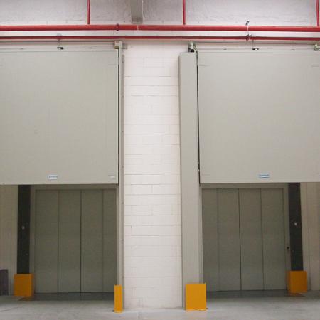 Proind puertas met licas automatismos barcelona for Puerta guillotina
